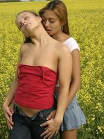 sweet teens naked and licking pussy in a field of flowers